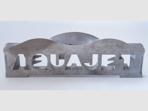 This plate illustrates the abilities of the 5-axis waterjet. The text reads the same from both sides, meaning that each letter transitions to a different letter on the opposite side.
