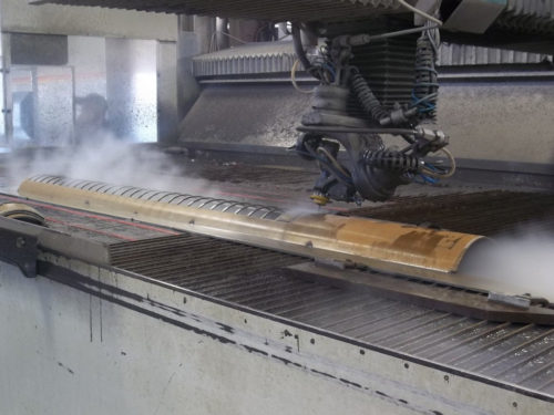 Cutting windows into a rolled steel plate using our 5-axis waterjet. Watch the Video