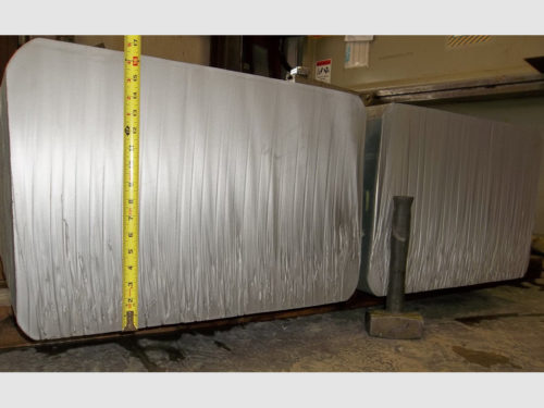 """Waterjet cut through a 16-1/2"""" thick billet of Waspaloy (a high strength super alloy). The 10,000 pound billet was severed into four pieces. Learn More About This Project"""