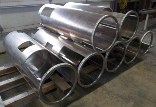 Aquajet services 5 axis waterjet cutouts in large tubes
