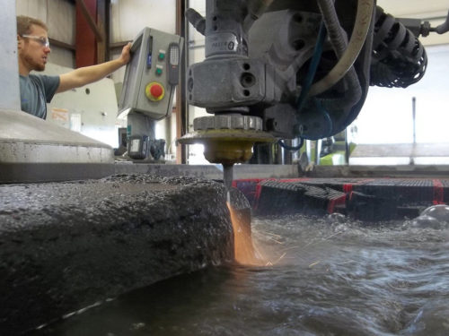 Waterjet cutting a 7' thick ingot of a niobium alloy into slices.