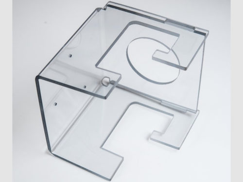 """This bracket was waterjet cut and formed out of a single piece of 3/16"""" thick polycarbonate, to replace the customer's original design which consisted of four individual pieces, pinned together."""